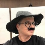Photo of Deb Brandon wearing a mustache