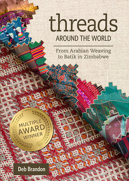 "Cover image for ""Threads Around the World"""